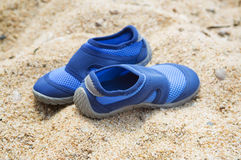 Shoes on a beach sand Stock Photo