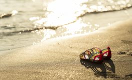 Shoes on the beach in sunset time Stock Photo