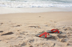 Shoes on the beach. In thailand Stock Photos