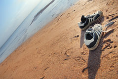 Shoes of beach the traveller Royalty Free Stock Photo
