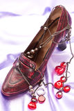Shoes and beads Stock Photography