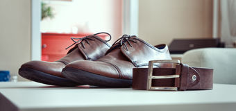 Shoes and belt. Brown boots and a brown belt Royalty Free Stock Photo