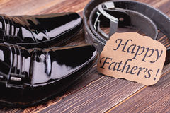Shoes and belt on wood. Royalty Free Stock Image