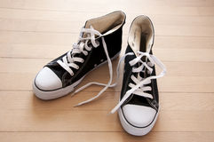 Shoes black. A pair of black shoes on wooden surface Royalty Free Stock Photos