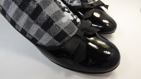 Patent leather shoes and checkered black and white socks Stock Photography