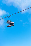 Shoes on a blue sky Stock Photo