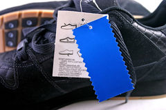 Shoes with blue tag. Black shoes with blue tag close up or macro royalty free stock images