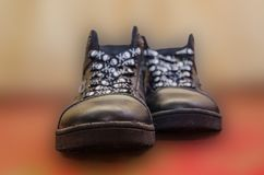 Shoes on a blurry background. Shoes on a blurry background, interesting baby shoelaces Stock Photo