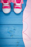 Shoes and bodysuits for newborn, expecting for baby, copy space for text Stock Photo