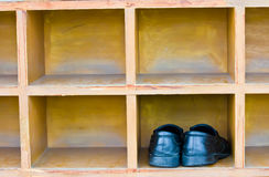 Shoes, boots stand on a rack Royalty Free Stock Photo