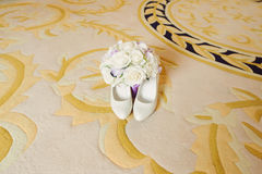 Shoes and Bouquet on Carpet Stock Photography