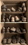 Shoes box. Toned image of an old wooden shoes box with a lot of different footwear inside Royalty Free Stock Photos