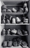 Shoes box. An old wooden shoes box with a lot of different footwear inside Royalty Free Stock Photos
