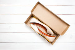 Shoes in a box Royalty Free Stock Image