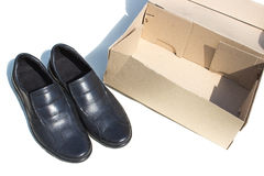 Shoes and box Stock Photography