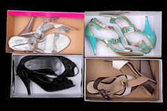Shoes in boxes Royalty Free Stock Photo