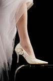 Shoes of the bride. Beautiful modelling magnificent shoes for the bride Stock Image
