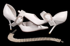 Shoes of the bride. Beautiful modelling magnificent shoes for the bride Royalty Free Stock Images