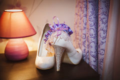 Shoes bride with garter Royalty Free Stock Photography