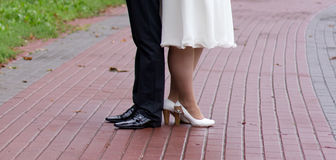 Shoes of a bride and groom walking Stock Images