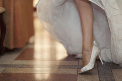 Shoes and bride's feet Royalty Free Stock Photos