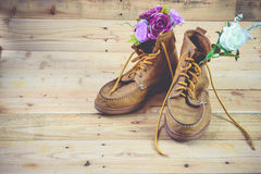Shoes. Brown leather boots on a wooden background Royalty Free Stock Photos
