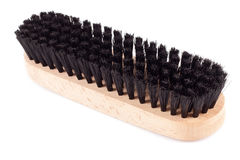 Shoes brush on a white background. New clothes (or shoe) brush with wooden handle  on the white background Royalty Free Stock Photos