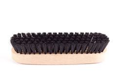 Shoes brush on a white background. New clothes (or shoe) brush with wooden handle isolated on the white background Stock Photo