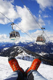 Shoes with cable lift in Alps Royalty Free Stock Photo