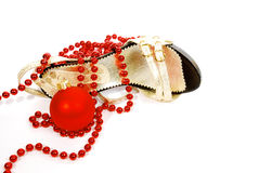 Shoes and Christmas ball Royalty Free Stock Photography