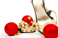 Shoes and christmas balls Stock Photos