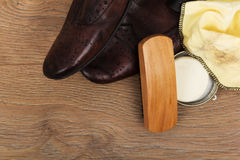 Shoes and cleaning equipment on a wooden floor Stock Photo