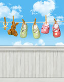 Shoes on clothesline wall background/backdrop Stock Image