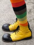 Shoes of the clown. Performer on the street with funny shoes Stock Photo