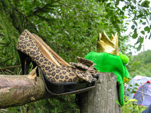 Shoes and comic headdress on the fence. Around the forest glade Royalty Free Stock Photos