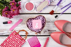Shoes, cosmetics and flowers. Royalty Free Stock Photos