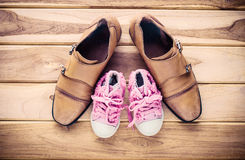 Shoes for dad and daughter - concept protect. Stock Images