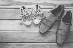 Shoes for dad and daughter tone black and white - concept protect. Stock Photo