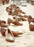 Shoes on the Danube bank, Budapest, Hungary, yellow filter Royalty Free Stock Photography