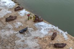 Shoes on the Danube shore, Budapest, Hungary royalty free stock photos