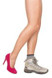 Shoes decision concept - High heels or sports shoe. Shoe choice concept image. Sexy woman legs wearing one high heels shoe and one hiking shoe Royalty Free Stock Photo
