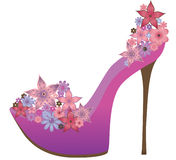 Shoes decorated with flowers. Stock Images