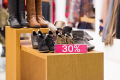 Shoes discount in store Royalty Free Stock Photos