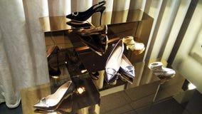 Shoes on display through window shop. Elegant high-heel shoes on display Stock Photo