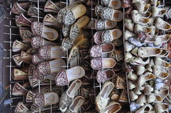 Shoes displayed in shop. Stacked traditional shoes displayed in shop Stock Photos
