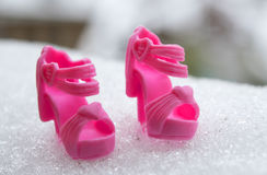 Shoes for dolls in the snow Royalty Free Stock Photos