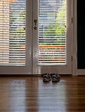 Shoes at the Door Royalty Free Stock Image