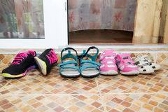 Shoes on  doorstep. Shoes on threshold the door Royalty Free Stock Photography