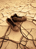 Shoes on a dry and hot ground in the mittle of nowhere Stock Photos