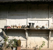 Shoes drying outside village house Stock Photos